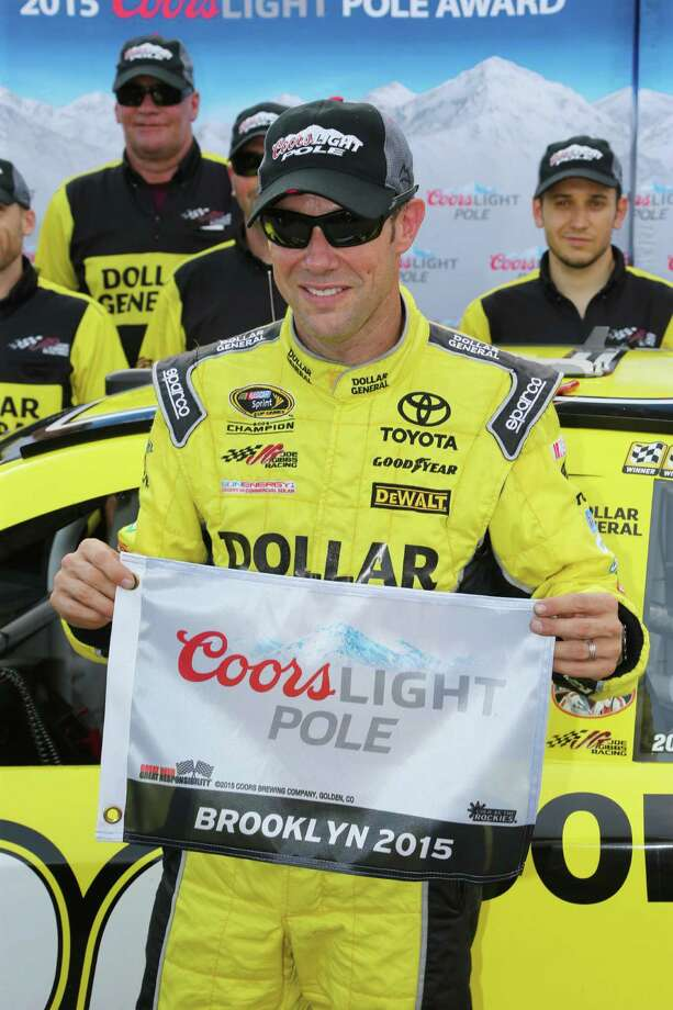 Matt Kenseth holds the pole position flag after qualifications Friday, Aug. 14, 2015, for the NASCAR Sprint Cup series auto race at Michigan International Speedway,in Brooklyn, Mich. (AP Photo/Bob Brodbeck) ORG XMIT: MICO108 Photo: Bob Brodbeck / FR3471 AP