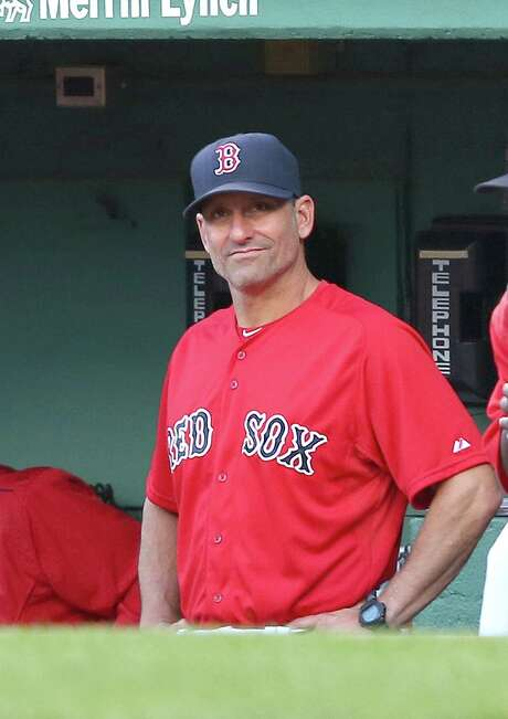 BOSTON, MA - AUGUST 14: Torey Lovullo #17 of the Boston Red Sox watches the action from the dugout as assumes the duties as manager during the first inning agains the Seattle Mariners at Fenway Park on August 14, 2015 in Boston, Massachusetts.  Manager John Farrell #53 of the Boston Red Sox has been diagnosed with Stage 1 lymphoma.(Photo by Jim Rogash/Getty Images) Photo: Jim Rogash, Stringer / 2015 Getty Images