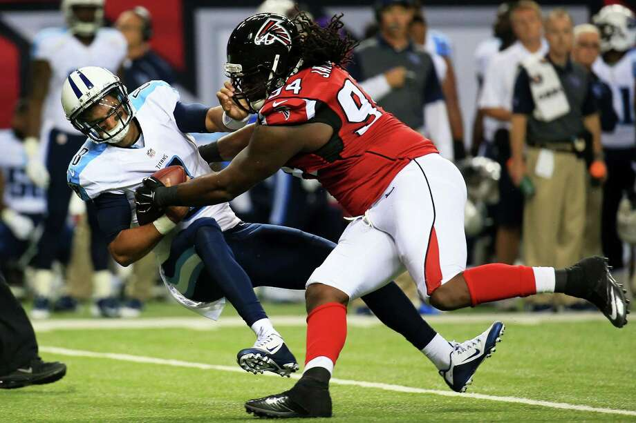 Tennessee rookie quarterback Marcus Mariota got a rather rude welcome to the NFL in his first preseason game Friday night when he was sacked by Atlanta's Tyson Jackson in the first half of the Titans' 31-24 loss at the Georgia Dome. Photo: Daniel Shirey, Stringer / 2015 Getty Images