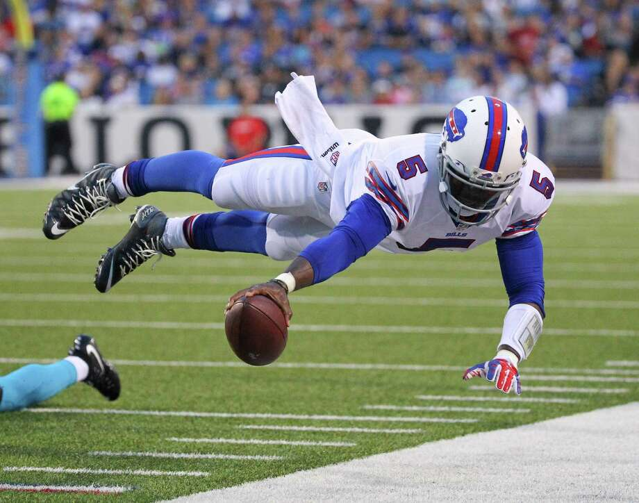 Buffalo Bills quarterback Tyrod Taylor (5) dives for the first down marker during the first half of an NFL preseason football game against the Carolina Panthers on Friday, Aug. 14, 2015, in Orchard Park, N.Y. (AP Photo/Bill Wippert)  ORG XMIT: NYMG114 Photo: Bill Wippert / FR170745 AP