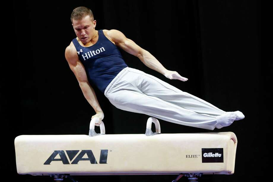 Jonathan Horton of Houston competes in pommel horse at the U.S. men's gymnastic championships Friday. He was in fourth place after the first round. Photo: AJ Mast, FRE / FR123854 AP