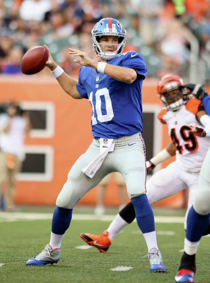 CINCINNATI, OH - AUGUST 14:  Eli Manning #10 of the New York Giants throws a pass against the Cincinnati Bengals during an preseason game at Paul Brown Stadium on August 14, 2015 in Cincinnati, Ohio.  (Photo by Andy Lyons/Getty Images) ORG XMIT: 558242231 Photo: Andy Lyons / 2015 Getty Images