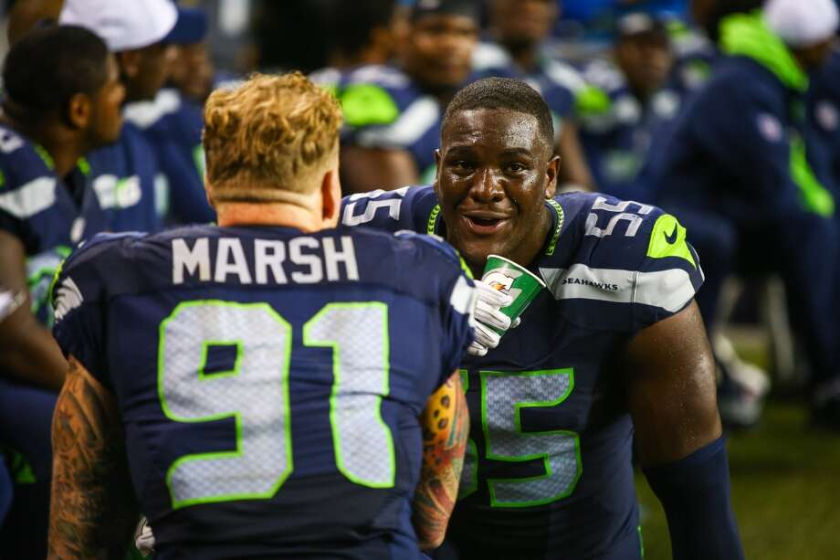 Seattle Seahawks player Frank Clark talks with teammate Cassius Marsh during a preseason NFL football game, Thursday, Sept. 3, 2015, in Seattle. Photo: JOSHUA TRUJILLO, SEATTLEPI.COM