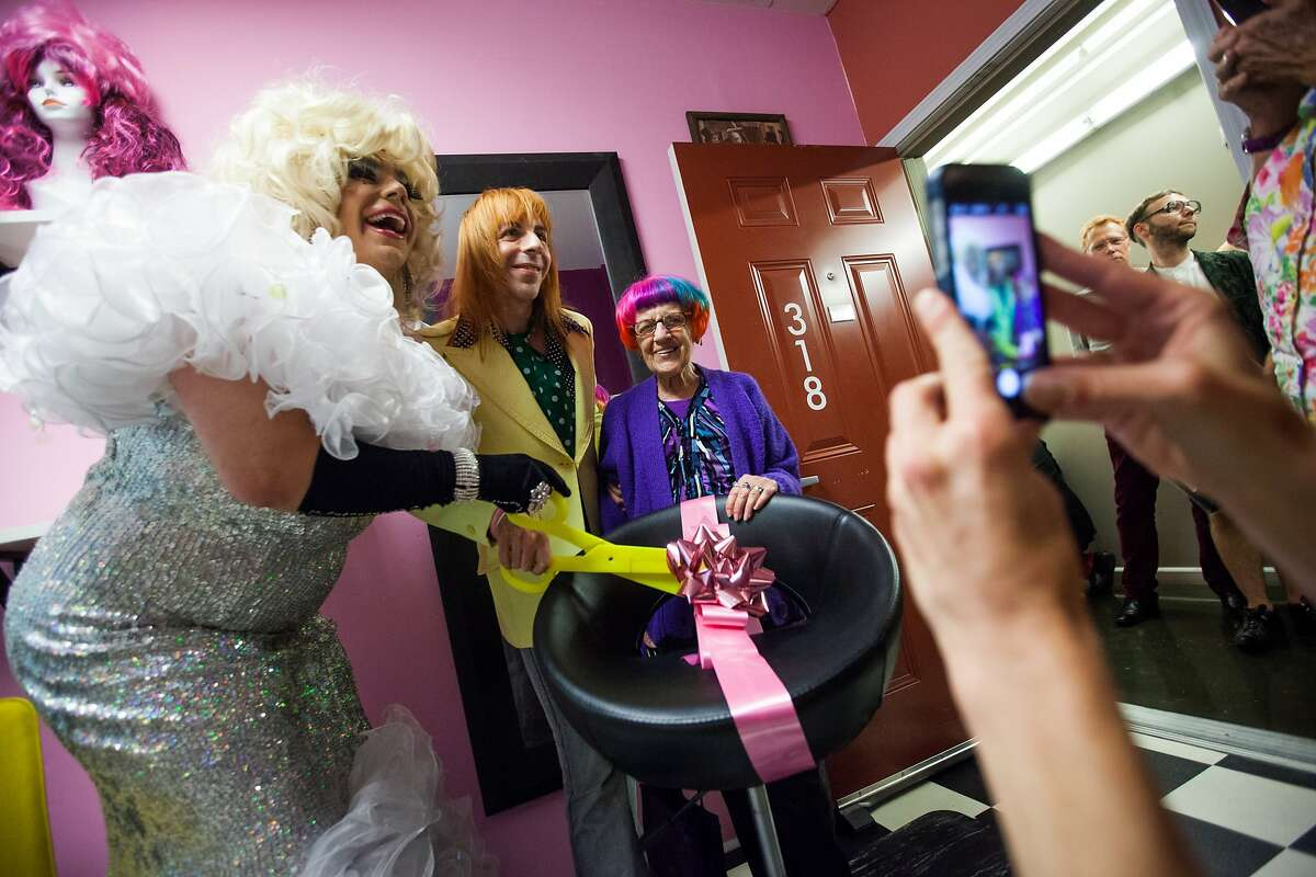 (l-r) Cruizin D'Loo, David Carver Ford, and Lillian Carver cut the ribbon at the opening night of Ford's new wig shop, Diva Hair in the Mission District of San Francisco, California, on Friday, Aug. 14, 2015. David Carver Ford will not only continue to make wigs for performers but will also help people with medical conditions leading to hair loss.