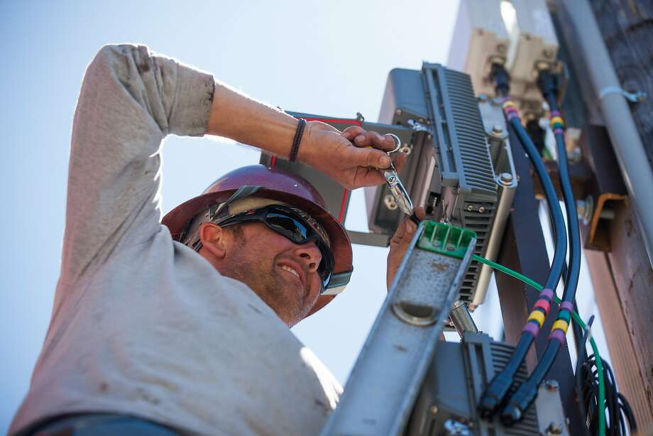 Brent Palmer, a contractor for Verizon Wireless, installs an antenna and cellular site on a telephone pole in San Francisco, California, on Friday, Aug. 14, 2015. Photo: Gabrielle Lurie, Special To The Chronicle