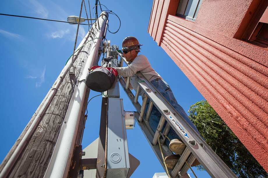 Brent Palmer, a Verizon Wireless contractor, installs cellular antenna equipment on a telephone pole in S.F. The company plans to install 400 more sites this fall. Photo: Gabrielle Lurie, Special To The Chronicle