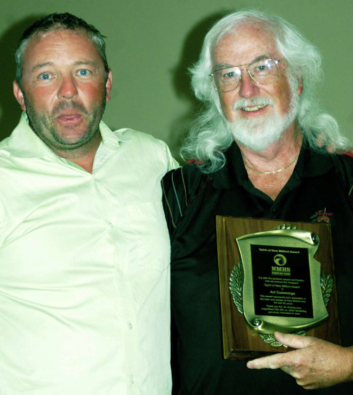 Steve Byrne, left, director of the New Miilford High School Reunion Classic golf tournament, poses with Art Cummings, the event's inaugural