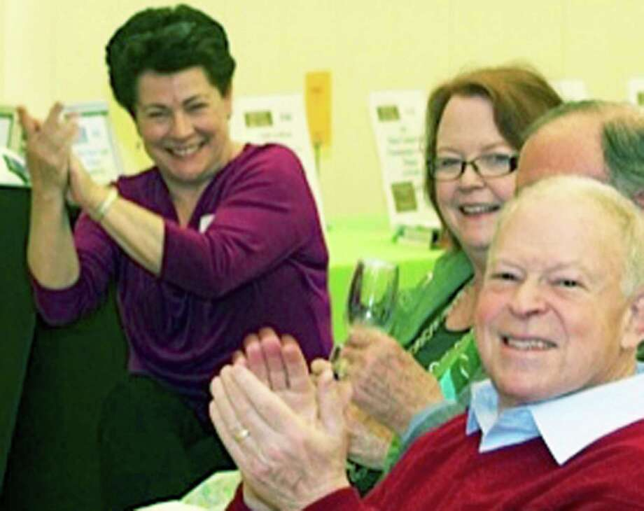 Among those on hand to applaud Literacy Volunteers' efforts are board president Jan Kamm, left, and tutors Eileen Monaghan and Norman Adler. Photo: Contributed Photo / Contributed Photo / The News-Times Contributed