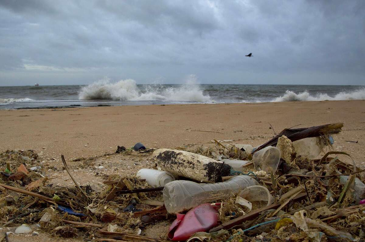 In this Aug. 13, 2015 photo, a plastic bottle lies among other debris washed ashore on the Indian Ocean beach in Uswetakeiyawa, north of Colombo, Sri Lanka.