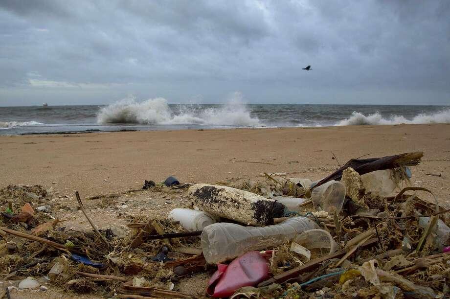 In this Aug. 13, 2015 photo, a plastic bottle lies among other debris washed ashore on the Indian Ocean beach in Uswetakeiyawa, north of Colombo, Sri Lanka. Photo: Gemunu Amarasinghe, Associated Press