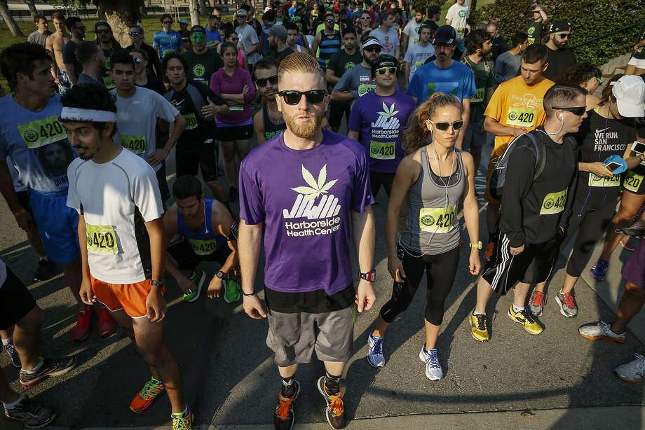 "Runners ready themselves at the starting line for a ""Four-Twenty Games"" fun run in Golden Gate Park on Saturday, Aug. 15, 2015. The Four-Twenty Games aim to ""destigmatize millions of responsible, positive cannabis users through athletic achievement."" Photo: Loren Elliott, The Chronicle"