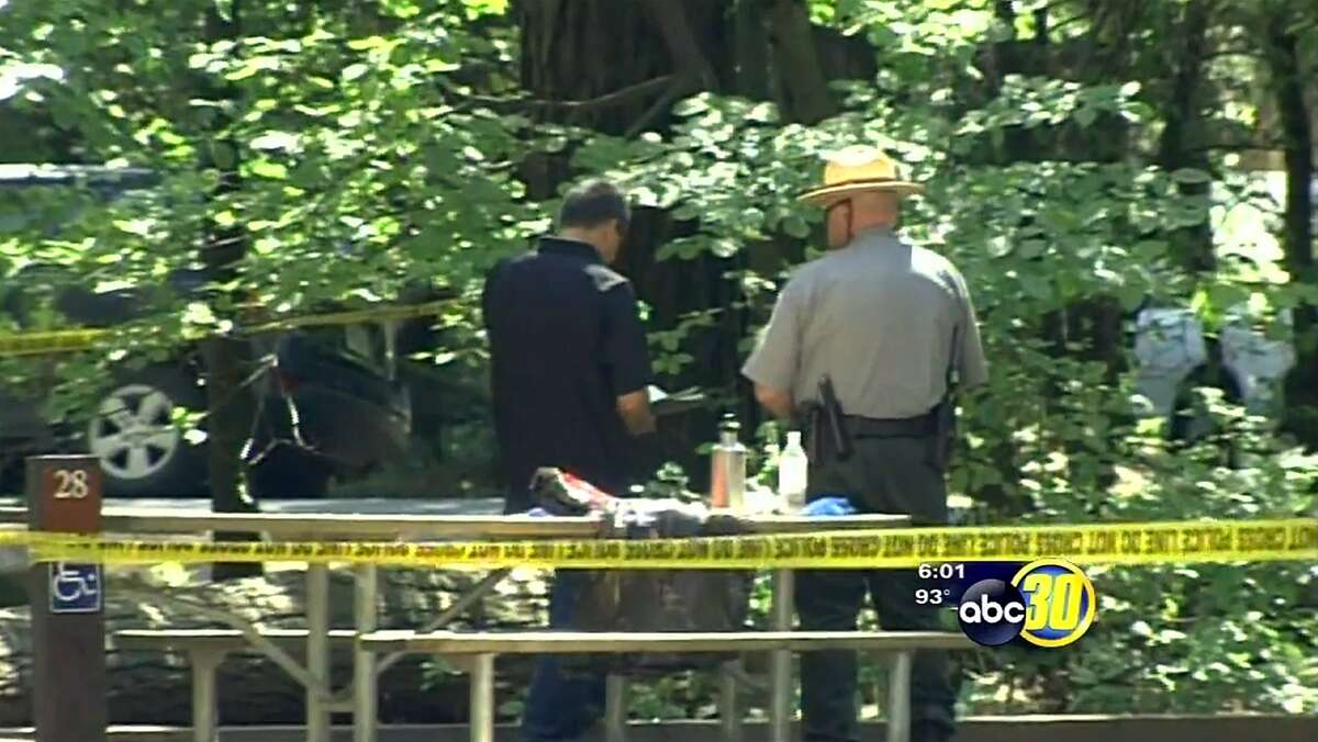 In this frame made from a video provided by KFSN-TV-abc30 investigators view the area where a portion of an oak tree that split away, falling to the ground and killing two young campers in a tent at the Upper Pines campground in Yosemite National Park, Calif., Friday, Aug. 14, 2015. Park spokesman Scott Gediman declined to release the ages or any details about the two, describing them only as under age 18. (KFSN-TV-abc30 via AP)