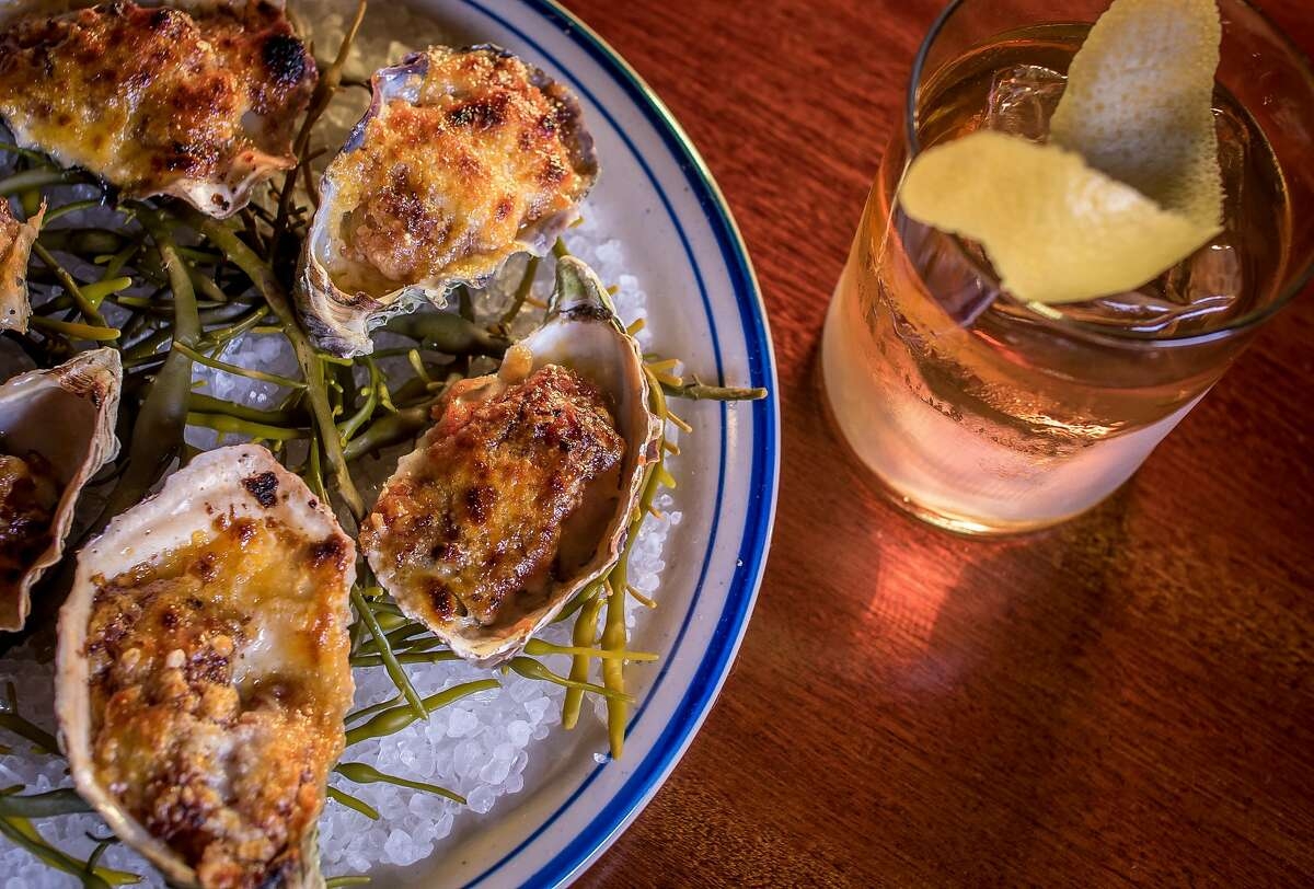 """The broiled Oysters with the """"Golden Era"""" cocktail at the Viking Room in San Francisco, Calif., are seen on August 14th, 2015."""