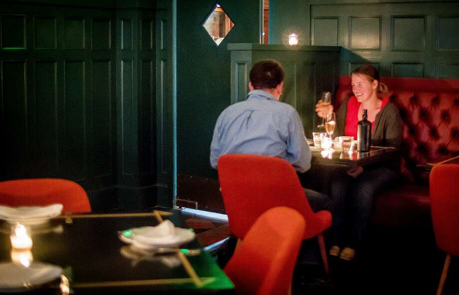 People dine at Cafe du Nord's Viking Room. Photo: John Storey, Special To The Chronicle