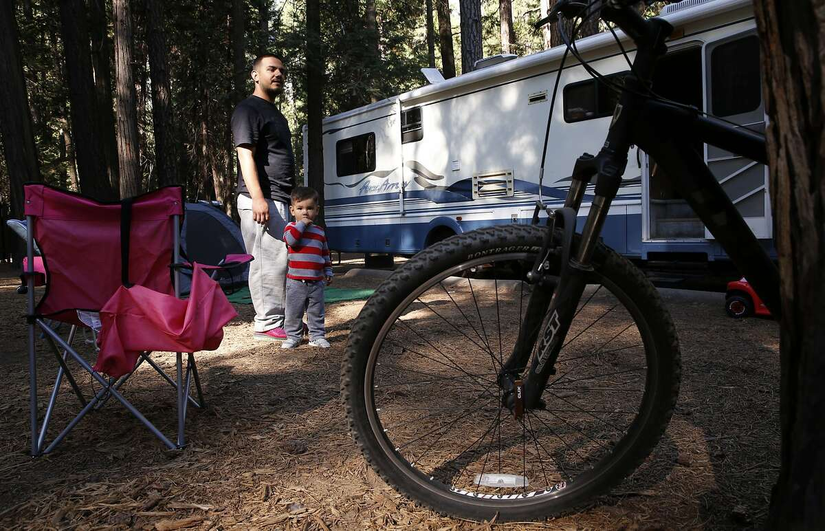 Ron Avila of Los Angeles with his son King, 5 read about the plague warnings online before arriving at Yosemite and took precautions to defend against it, as they camp at Upper Pines campground in Yosemite National Park, Calif., on Sat. August 15, 2015.