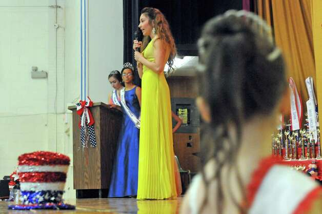 Four-teen-year-old Whitney Wilson, center, competes in the 2015 Miss Uncle Sam pageant at the St. Augustine's Church Hall on Saturday Aug. 15, 2015 in Troy, N.Y.  (Michael P. Farrell/Times Union) Photo: Michael P. Farrell / 00033013A