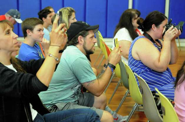 Parents take photographs of contestants in the 2015 Miss Uncle Sam pageant at the St. Augustine's Church Hall on Saturday Aug. 15, 2015 in Troy, N.Y.  (Michael P. Farrell/Times Union) Photo: Michael P. Farrell / 00033013A
