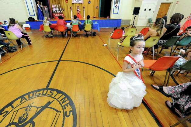 Five-year-old 2014 Little Miss Troy Faith French serves as escort to this years contestants  in the 2015 Miss Uncle Sam pageant at the St. Augustine's Church Hall on Saturday Aug. 15, 2015 in Troy, N.Y.  (Michael P. Farrell/Times Union) Photo: Michael P. Farrell / 00033013A