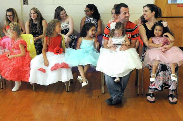 Young contestants wait to compete in the 2015 Miss Uncle Sam pageant at the St. Augustine's Church Hall on Saturday Aug. 15, 2015 in Troy, N.Y.  (Michael P. Farrell/Times Union) Photo: Michael P. Farrell / 00033013A