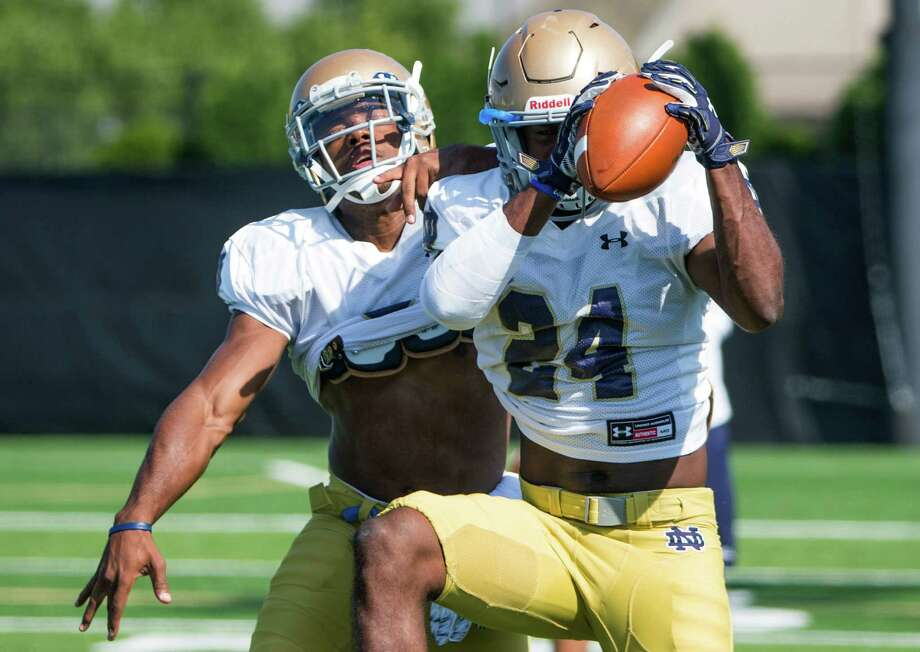 Notre Dame's KeiVarae Russell, left, and Nick Coleman participate in Notre Dame's NCAA college football practice Thursday, Aug. 13, 2015, in South Bend, Ind. (Robert Franklin/South Bend Tribune via AP) Photo: Robert Franklin, MBO / Associated Press / South Bend Tribune