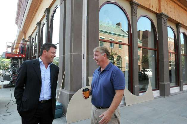 Robert Pasinella, left, executive direcrtor of the Rensselaer County IDA and owner/architect David Bryce in front of the nearly completed Quackenbush Building on Friday Aug. 14, 2015 in Troy N.Y. First floor will be occupied by Tech Valley Center of Gravity. Vital Vio will manufacturing lighting fixtures for health care applications that kill microbes. Ribbon cutting is next Wednesday. (Michael P. Farrell/Times Union) Photo: Michael P. Farrell / 00033005A