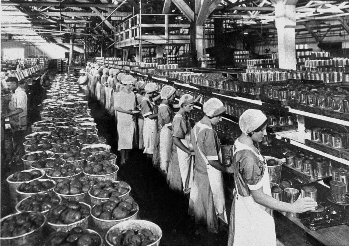 Women work at a Del Monte Corp. canning plant in the 1930s.