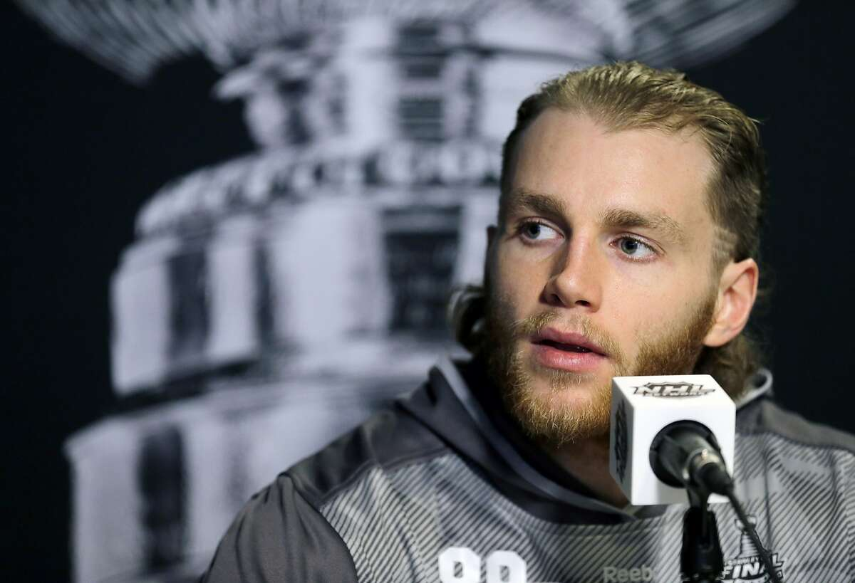 FILE - In this June 2, 2015, file photo, Chicago Blackhawks right wing Patrick Kane answers a question during media day for NHL hockey's Stanley Cup finals in Tampa, Fla. The police investigation of Blackhawks star Patrick Kane concerns something that happened between the player and a woman in her 20s, the AP is told. Police have said only that the inquiry involves an
