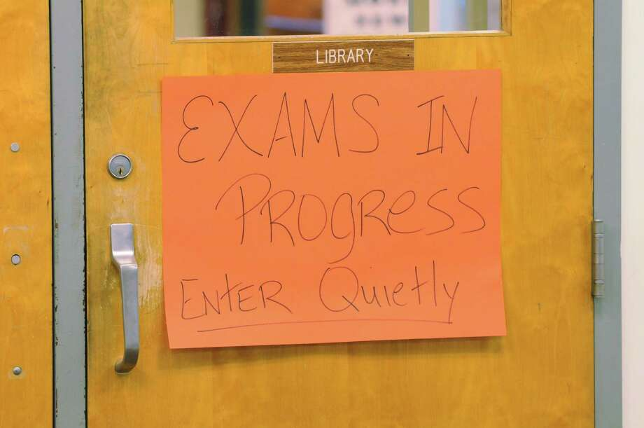 Exams are taken at Burnt Hills-Ballston Lake High School, Friday, June 7, 2013, in Burnt Hills, N.Y. The sign was placed on the school library door. (Will Waldron/Times Union) Photo: Will Waldron / 00022490A