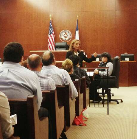 State District Judge Denise Collins fields questions as she begins the process of picking the first grand jury in Harris County, if not the state, to comply with the new semi-random system. lawmakers approved this year. The law goes into effect in September, but Collins began the process of picking her grand jury for October.  