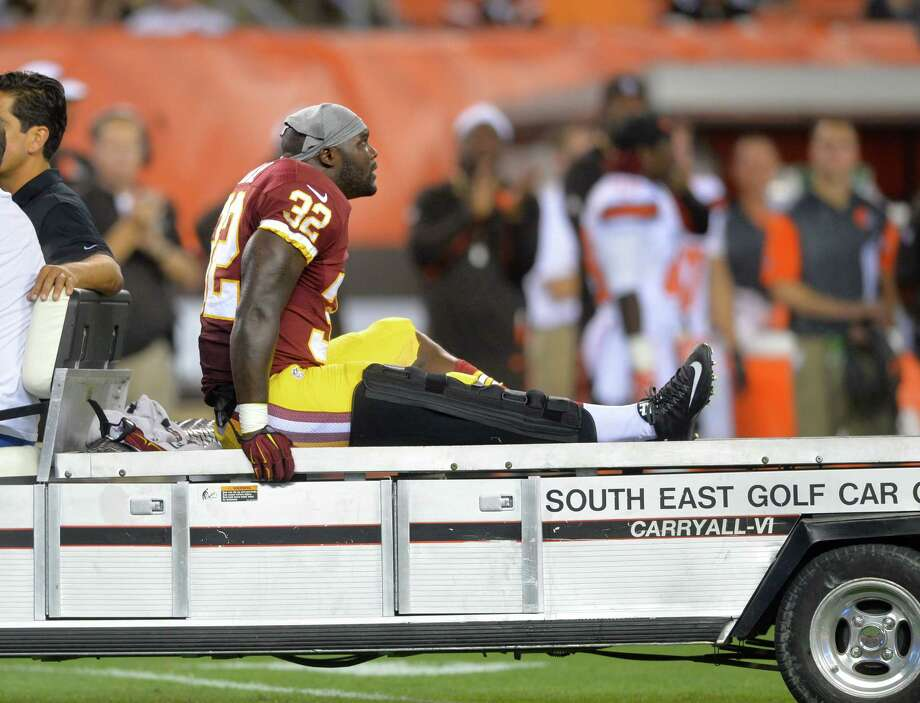 Washington Redskins running back Silas Redd Jr. (32) is carted off the field in the third quarter against the Cleveland Browns during an NFL preseason football game Thursday, Aug. 13, 2015, in Cleveland. Washington won 20-17. (AP Photo/David Richard) Photo: David Richard / AP / FR25496 AP