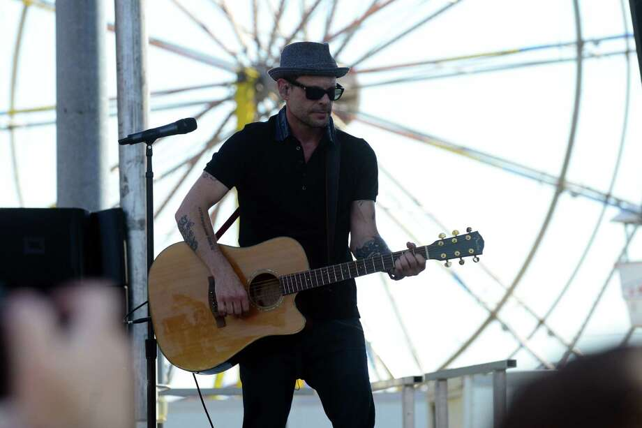 Robin Wilson of the Gin Blossoms headlines the 41st Annual Milford Oyster Festival in downtown Milford, Conn., on Saturday Aug. 15, 2015. Some of the other national acts the performed were Fastball and The Rembrandts. There were amusement rides, arts & crafts, a car and motorcycle show and the most variety of oysters from eight states. Photo: Christian Abraham, Hearst Connecticut Media / Connecticut Post