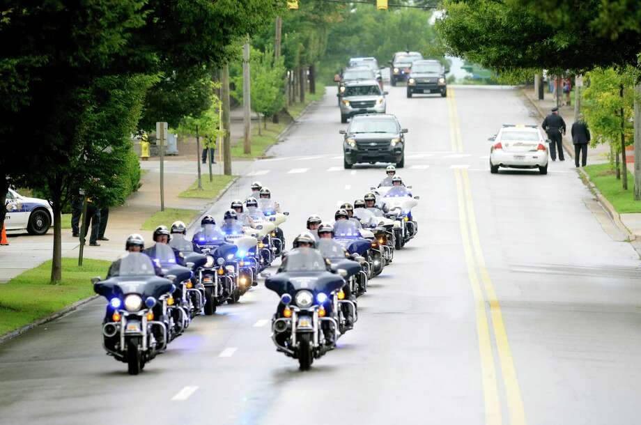 Vice President Joe Biden motorcade arrives at McKenzie Arena in Chattanooga, Tennessee memorial service Saturday, Aug. 15, 2015, in Chattanooga, Tenn. The service is for four Marines and a sailor killed as a result of attacks on a military recruiting station and a Naval operations center July 16 in Chattanooga. (AP Photo/Mark Gilliland) Photo: Mark Gilliland, FRE / FR45967 AP