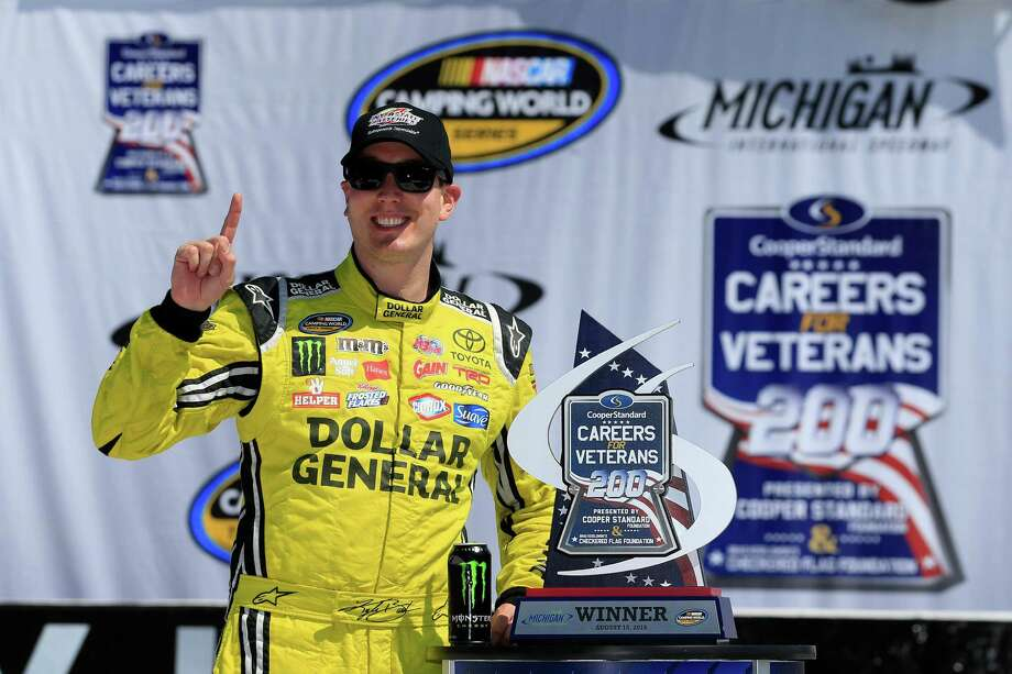 BROOKLYN, MI - AUGUST 15:  Kyle Busch, driver of the #51 Dollar General Toyota, celebrates in victory lane after winning the NASCAR Camping World Truck Series Careers for Veterans 200 at Michigan International Speedway on August 15, 2015 in Brooklyn, Michigan.  (Photo by Chris Trotman/Getty Images) ORG XMIT: 570131359 Photo: Chris Trotman / 2015 Getty Images