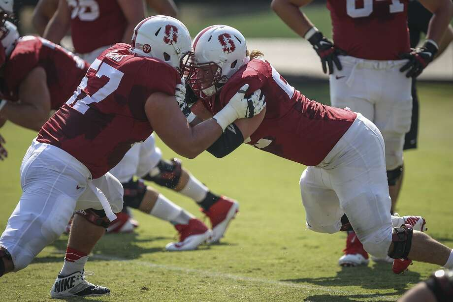 Stanford center Graham Shuler (right) faces off against Johnny Caspers during practice at Stanford University on Saturday, Aug. 15, 2015. Photo: Loren Elliott, The Chronicle