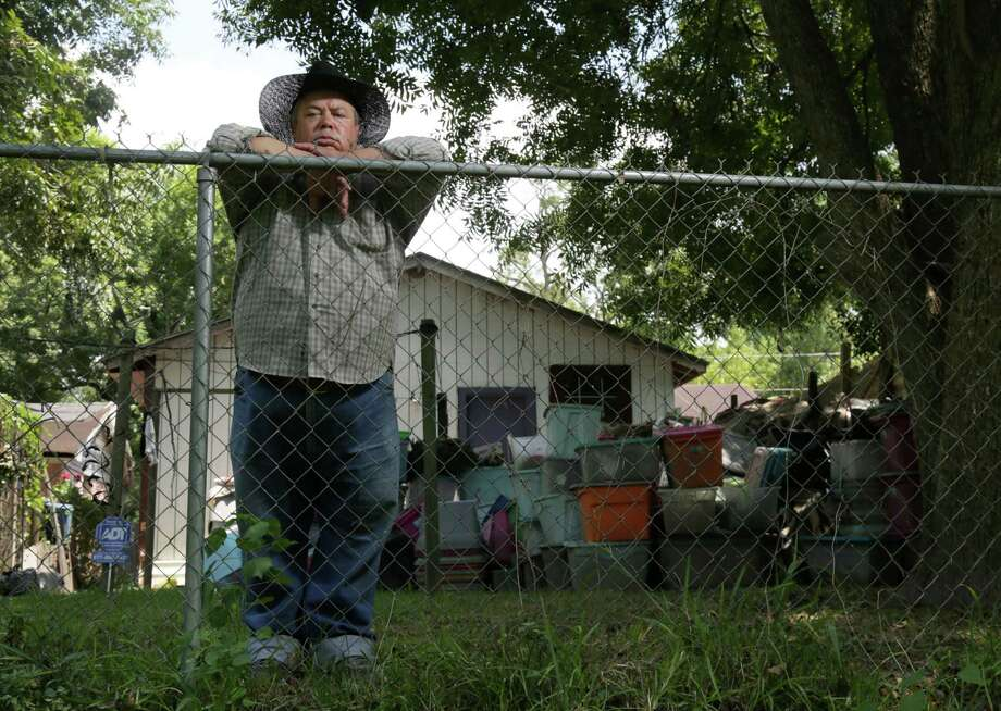 Raul Vargas' sister, Angelina Garcia, had to tempor-arily move out of her home last week as pest control removed three snakes. A snake expert says the Memorial Day flooding likely didn't cause the problem. Photo: Jon Shapley, Staff / © 2015 Houston Chronicle