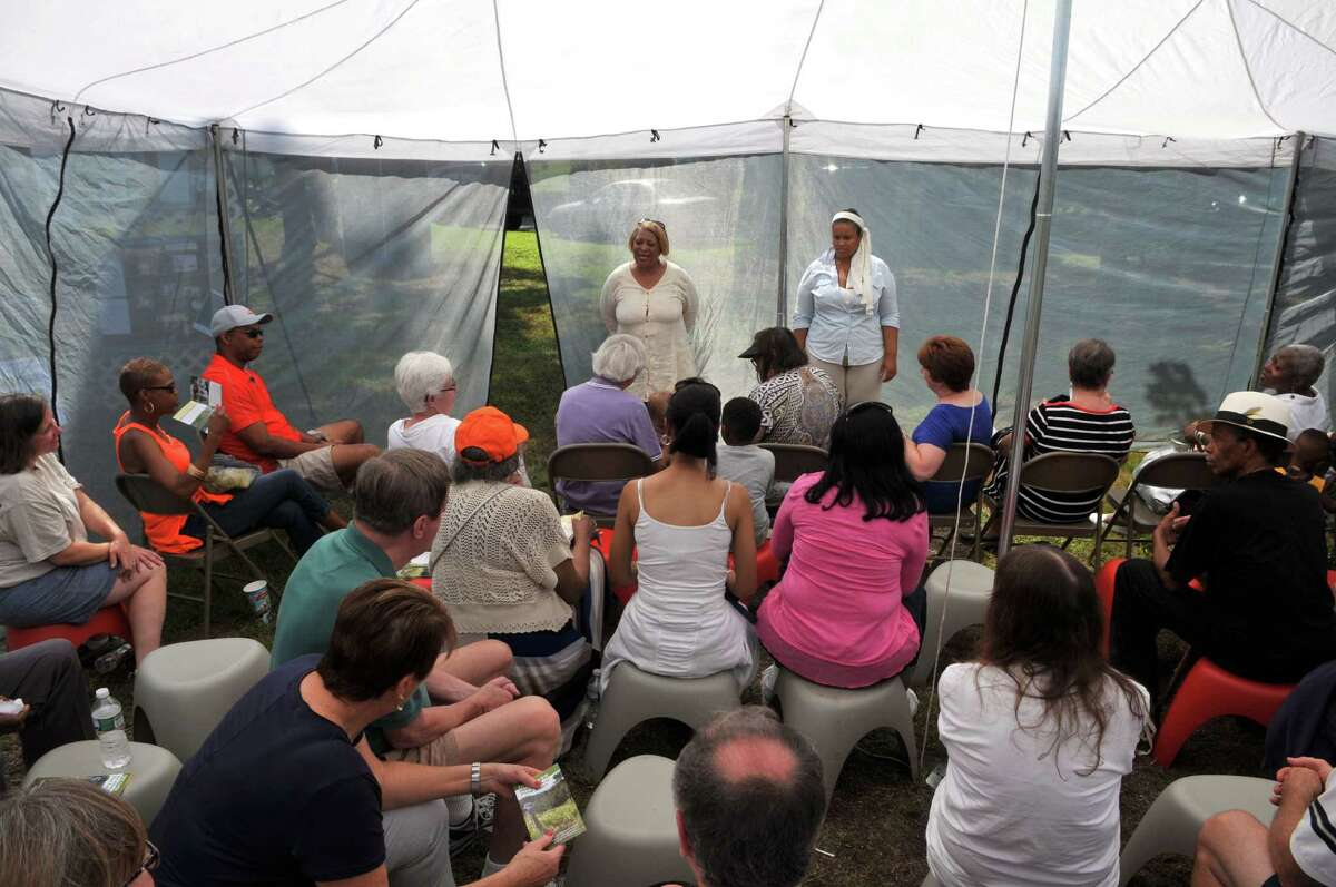 The crowd listens as Beverly Bardequez, back left, talks about the history of Rapp Road on Saturday, Aug 15, 2015, in Albany, N.Y. (Phoebe Sheehan/Special to The Times Union)