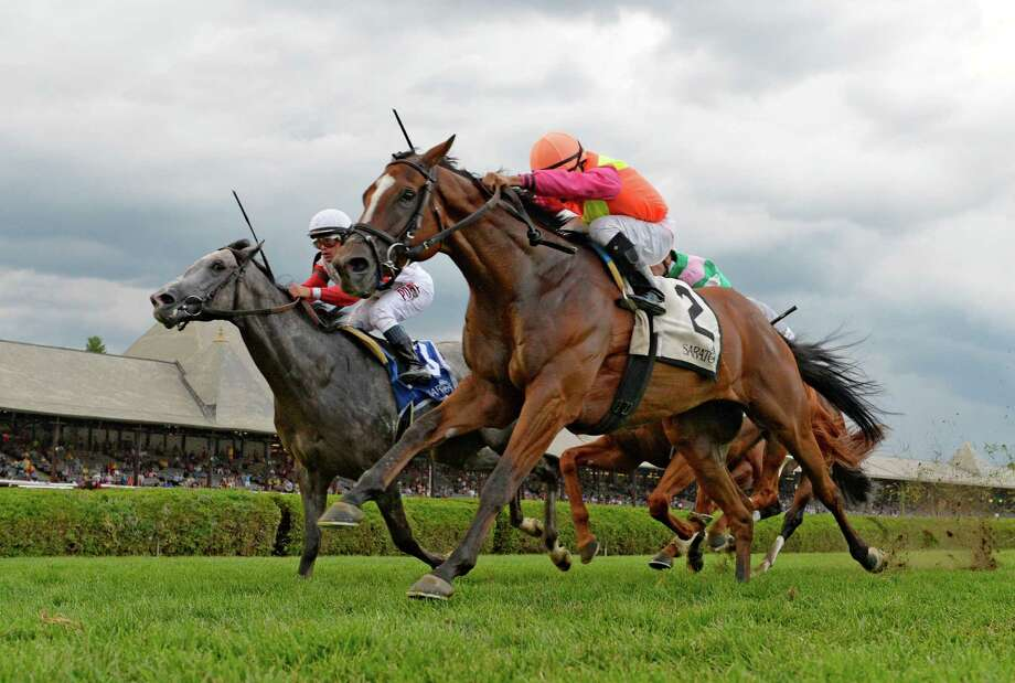 Grand Arch with jockey Luis Saez puts away the competition for the win in the Fourstardave stakes Saturday afternoon Aug. 15, 2015,  at the Saratoga Race Course in Saratoga Springs, N.Y.  (Skip Dickstein/Times Union) Photo: SKIP DICKSTEIN