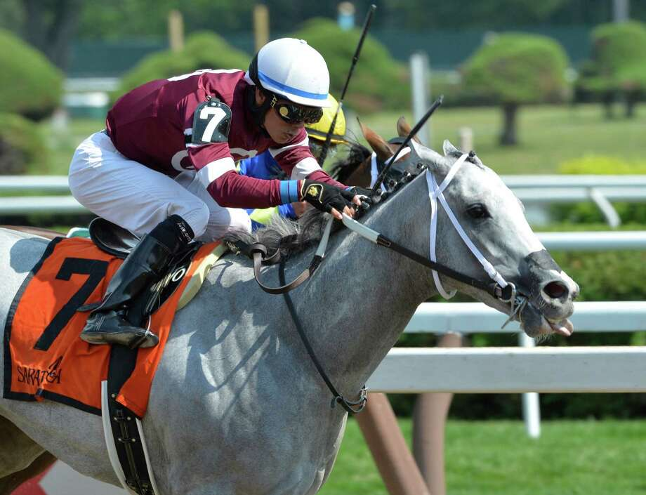 #7 Just Wicked with jockey Jose Ortiz duels to the finish line with #5 Tonasah with jockey Javier Castellano and the win in the 99th running of The Adirondack Saturday afternoon Aug. 15, 2015,  at the Saratoga Race Course in Saratoga Springs, N.Y.  (Skip Dickstein/Times Union) Photo: SKIP DICKSTEIN