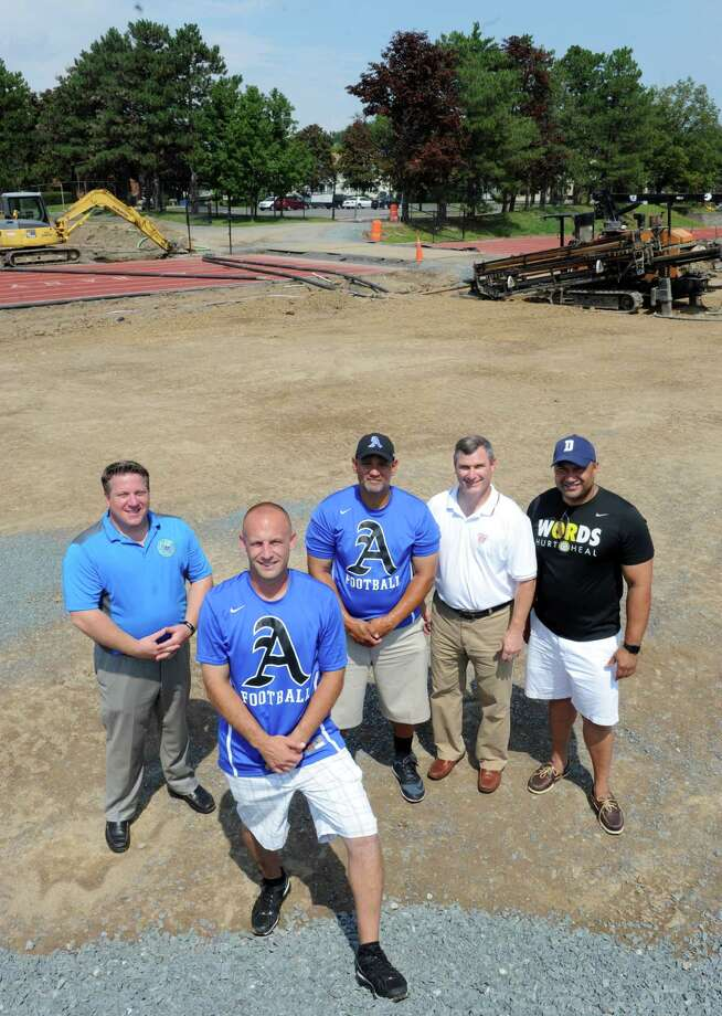 Albany High football coach Joey DiPiazza, foreground, with Albany County Executive Dan McCoy, left, strength and conditioning coach Lawrence Oliver, Police Chief Brendan Cox and Albany County District Attorney P. David Soares on the under construction new Albany High School football field on Saturday Aug. 15, 2015 in Albany, N.Y.  (Michael P. Farrell/Times Union) Photo: Michael P. Farrell / 00033012A
