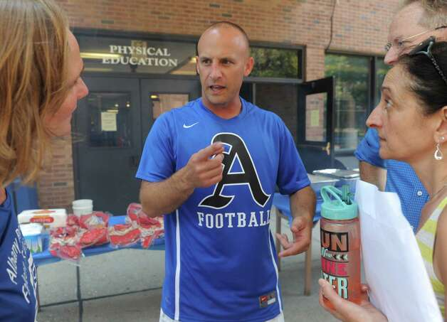 Albany High football coach Joey DiPiazza, center, during a barbecue for his team and Albany youth football on Saturday Aug. 15, 2015 in Albany, N.Y.  (Michael P. Farrell/Times Union) Photo: Michael P. Farrell / 00033012A