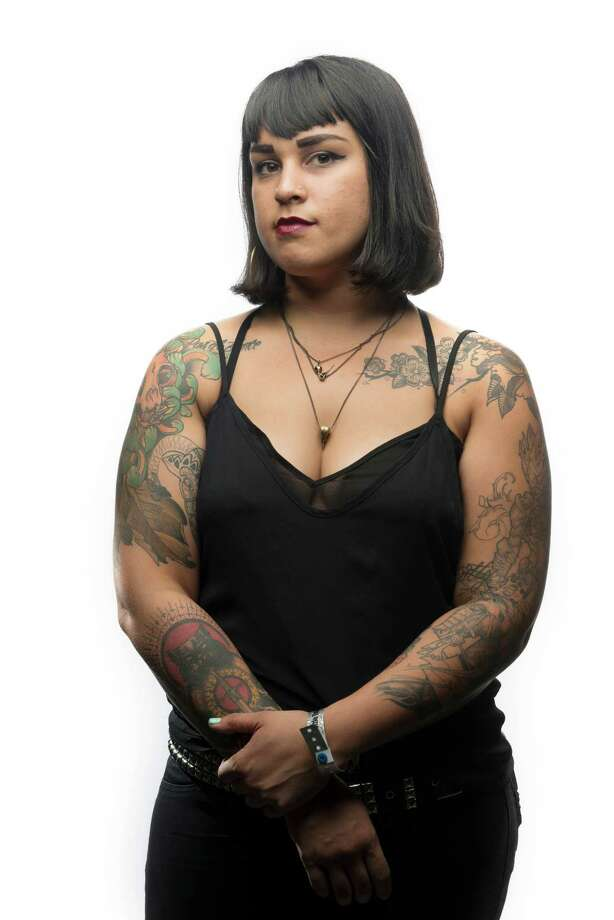 """As long as I can remember I've been drawing on myself,"" said Angela Yonker of Seattle during the Seattle Tattoo Expo at Fisher Pavilion in Seattle Center. Yonker got her first tattoo when she turned 18. Photo: DANIEL BERMAN, SPECIAL TO SEATTLEPI.COM / SPECIAL TO SEATTLEPI.COM"