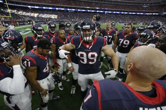 Houston Texans defensive end J.J. Watt (99) gathers his teammate before the first quarter of an NFL pre-season football game against the San Francisco 49ers at NRG Stadium on Saturday, Aug. 15, 2015, in Houston. ( Brett Coomer / Houston Chronicle )