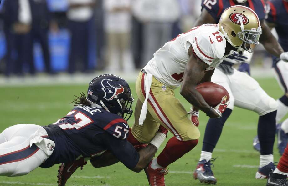 Houston Texans inside linebacker Justin Tuggle (57) stops San Francisco  49ers wide receiver DeAndrew 3e84a6d85