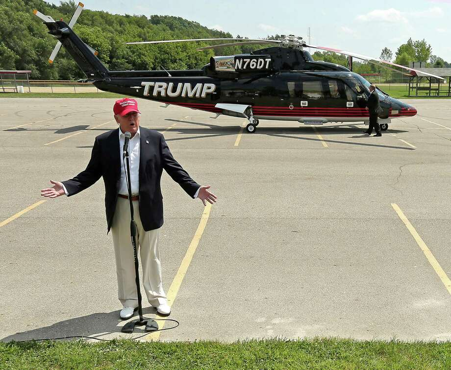Republican presidential candidate Donald Trump  talks to the media after arriving by helicopter at a nearby ballpark before Trump attended the Iowa State Fair Saturday, Aug. 15, 2015, in Des Moines. (AP Photo/Charlie Riedel) Photo: Charlie Riedel, Associated Press / AP