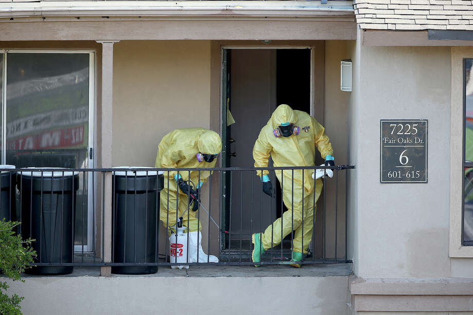 Most of the payments for Ebola cleanup went to the company Cleaning Guys. One of its teams is shown here on Oct. 6, 2014, sanitizing the apartment of patient Thomas Eric Duncan. Photo: Joe Raedle, Staff / 2014 Getty Images