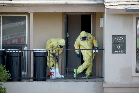 Most of the payments for Ebola cleanup went to the company Cleaning Guys. One of its teams is shown here on Oct. 6, 2014, sanitizing the apartment of patient Thomas Eric Duncan.