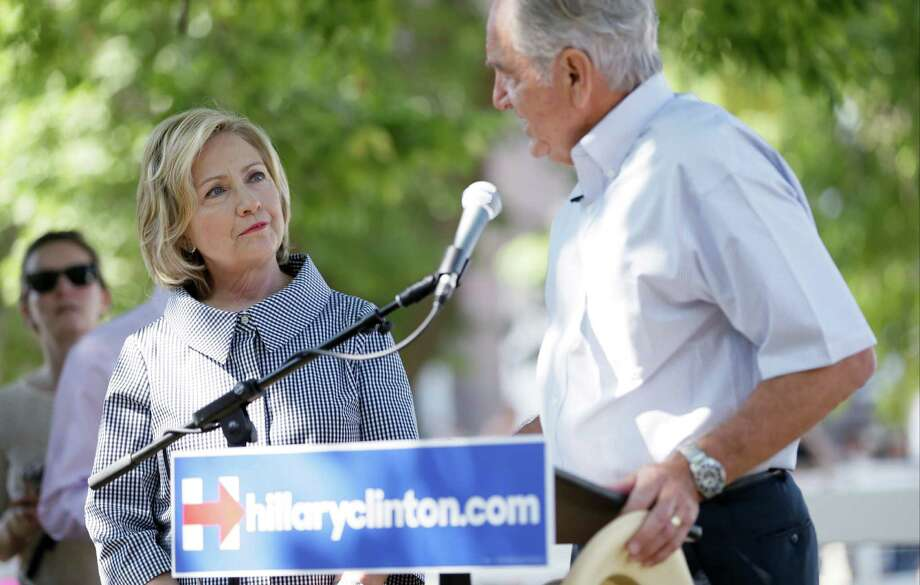 Democratic presidential candidate Hillary Rodham Clinton talks with former U.S. Sen. Tom Harkin, right, during a visit to the Iowa State Fair, Saturday, Aug. 15, 2015, in Des Moines, Iowa.  Photo: Charlie Neibergall, Associated Press / AP