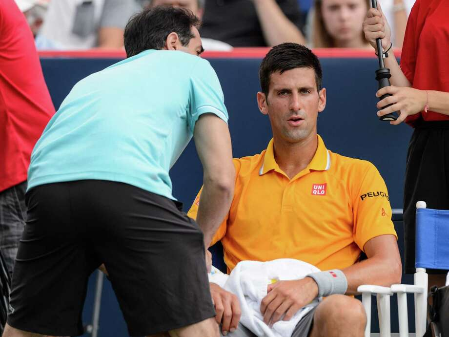 MONTREAL, ON - AUGUST 15:  Novak Djokovic of Serbia is treated by medical staff in his match against Jeremy Chardy of France during day six of the Rogers Cup at Uniprix Stadium on August 15, 2015 in Montreal, Quebec, Canada.  (Photo by Minas Panagiotakis/Getty Images) ORG XMIT: 559198859 Photo: Minas Panagiotakis / 2015 Getty Images