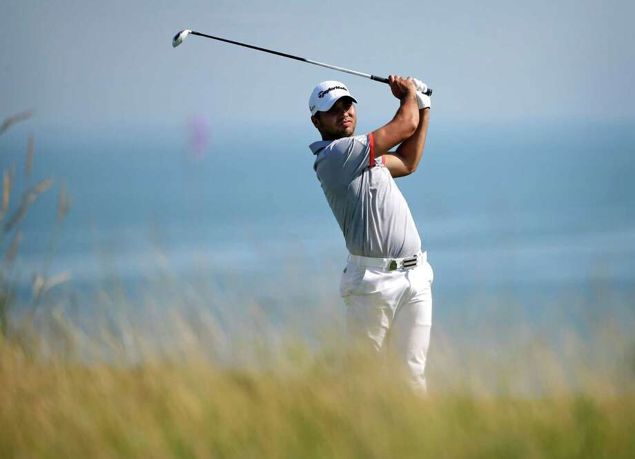 Jason Day, of Australia, hits on the fifth hole during the third round of the PGA Championship golf tournament Saturday, Aug. 15, 2015, at Whistling Straits in Haven, Wis. (AP Photo/Jae Hong)  ORG XMIT: PGA168 Photo: Jae Hong / AP