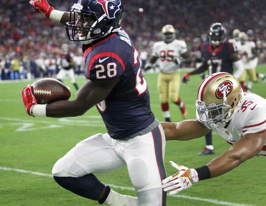 Texans running back Alfred Blue (28) is knocked out of bounds by 49ers free safety Eric Reid on Blue's 32-yard run during the second quarter of the preseason-opening win Saturday night. Photo: Brett Coomer, Staff / © 2015  Houston Chronicle